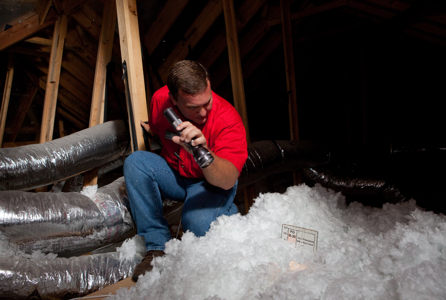 Man in attic with insulation