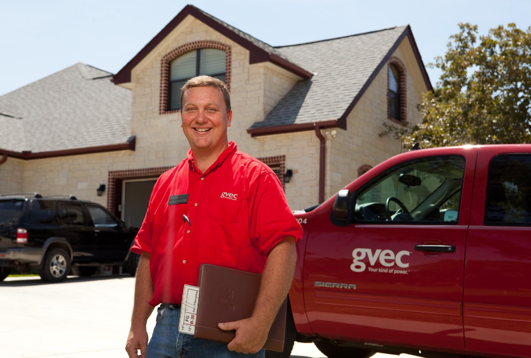 GVEC Energy Efficiency inspector standing next to truck