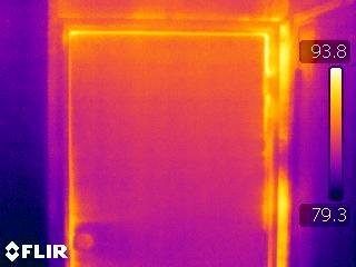 infrared image of heat infiltrating around an exterior door