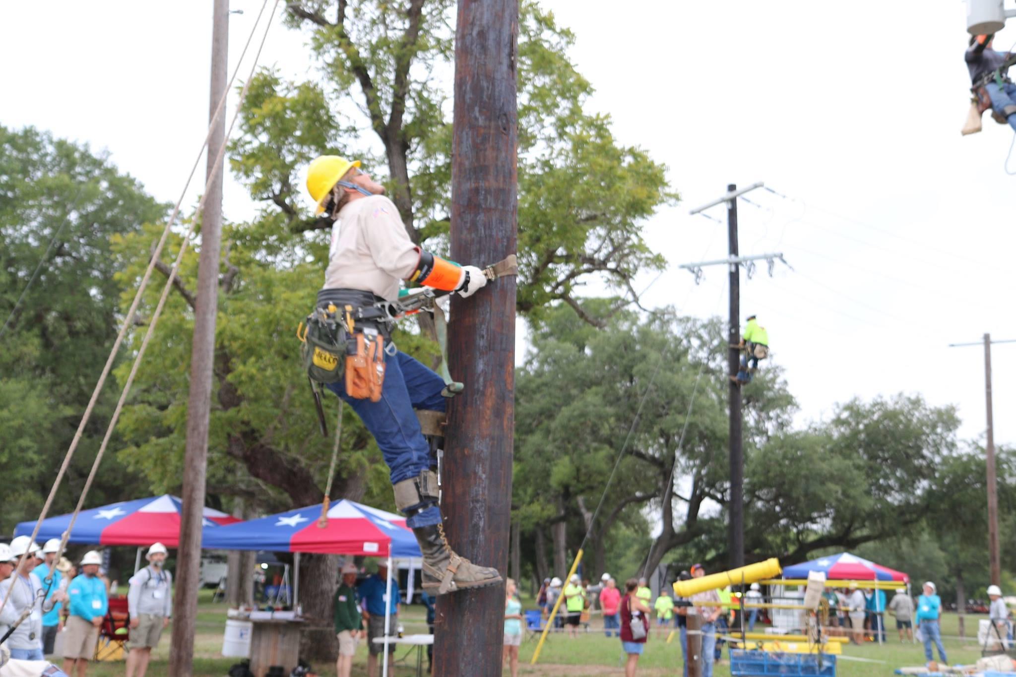 Apprentice lineman pole climb