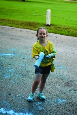 GVEC Gives Back Community Event Blue Team Little Girl with Powder Bottle