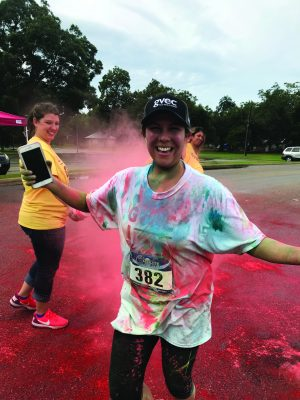 GVEC Gives Back Color Fun Run 5K Event Red Team Volunteer Covered & Reveling in Red Color Fun Run Dust