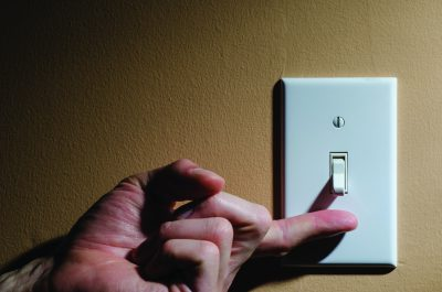 A light switch being turned on during a power outage