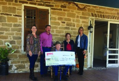 A pic of Polley Mansion owners accepting a check from GVEC