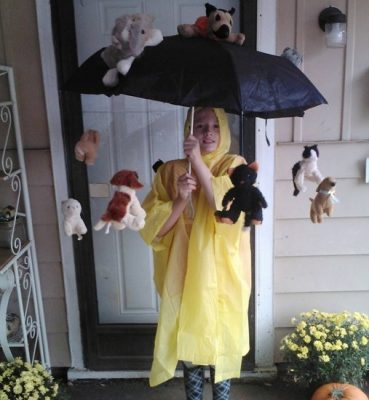 Picture of a young boy dressed in a yellow rain slicker and a cats and dogs storm-brella special Homemade Halloween Costume