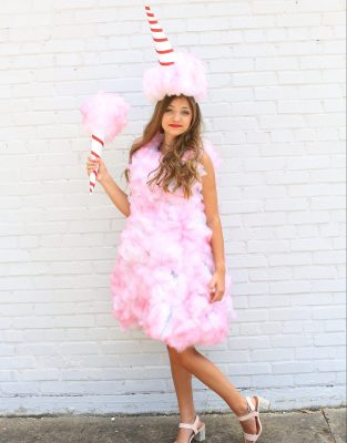 Picture of a young woman dressed in a pink cotton candy homemade Halloween Costume