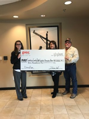 From left: Kasie Tankersley, community relations representative with the Guadalupe Valley Electric Cooperative (GVEC), presents a $3,000 donation to Charla Bading and Travis Franke of the Guadalupe County Youth Livestock and Homemakers Show, Guadalupe Valley Livestock Shows