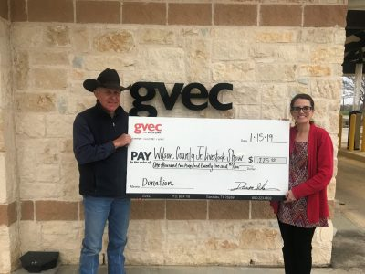 Tankersley presents a $1,225 donation to Mark Wehe of the 2019 Wilson County Junior Livestock Show, agriculture in the Guadalupe Valley
