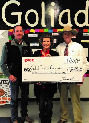 Center: Christine Presley, community relations representative from the Guadalupe Valley Electric Cooperative (GVEC), presents a $1,225.00 donation to Brian Yanta, Advisor, and Roy Boyd, Chairperson for the 2019 Goliad Co. Fair Association, Guadalupe Valley Livestock Shows
