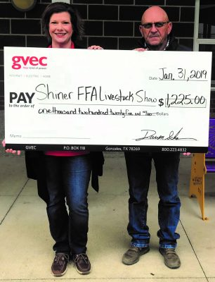 Christine Presley, community relations representative with the Guadalupe Valley Electric Cooperative (GVEC), presents a $1,225.00 donation to Bruce Pohler, FFA sponsor with the 2019 Shiner FFA Livestock Show, agriculture in the Guadalupe Valley